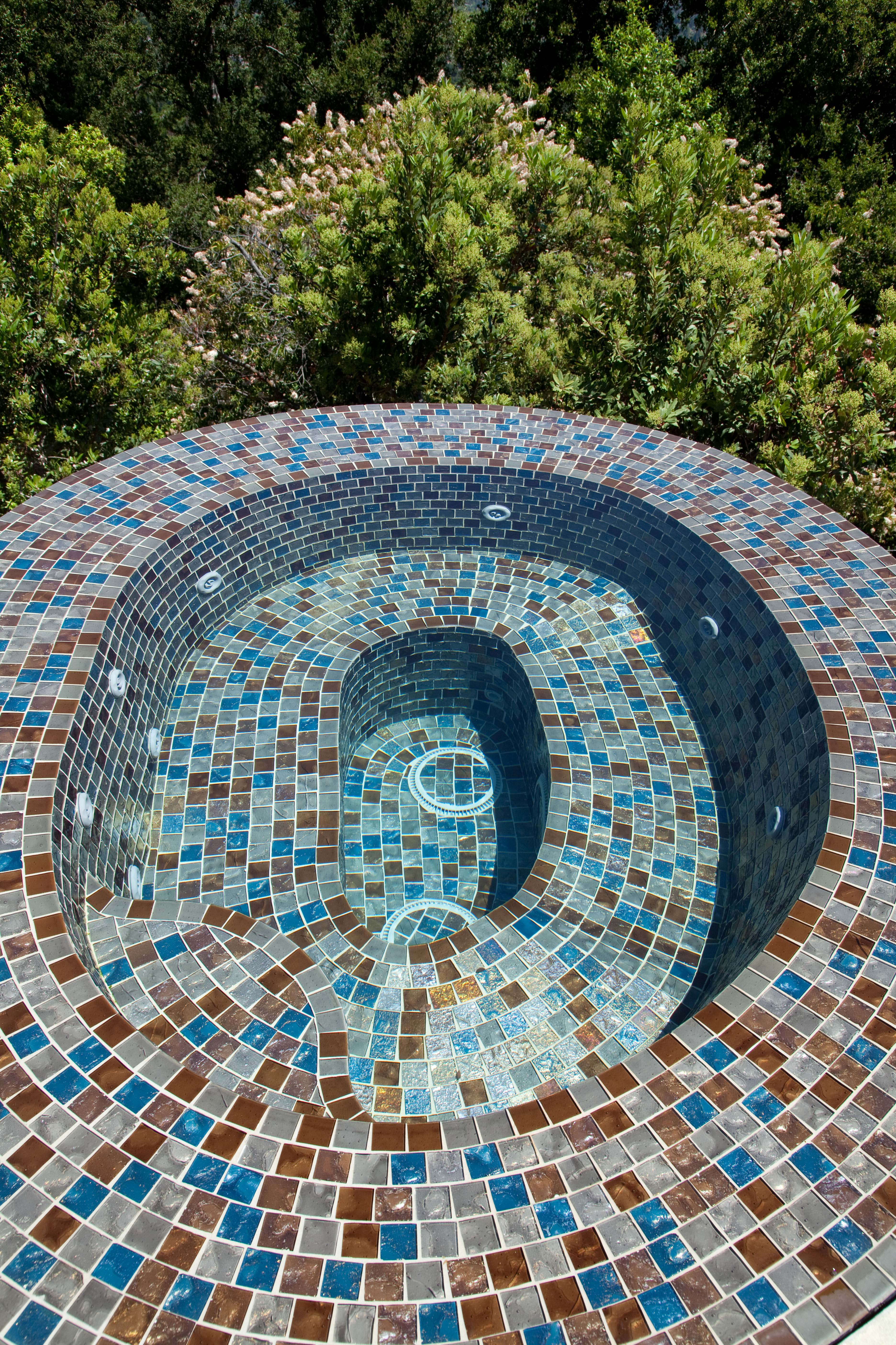 Vanishing edge glass tile spa