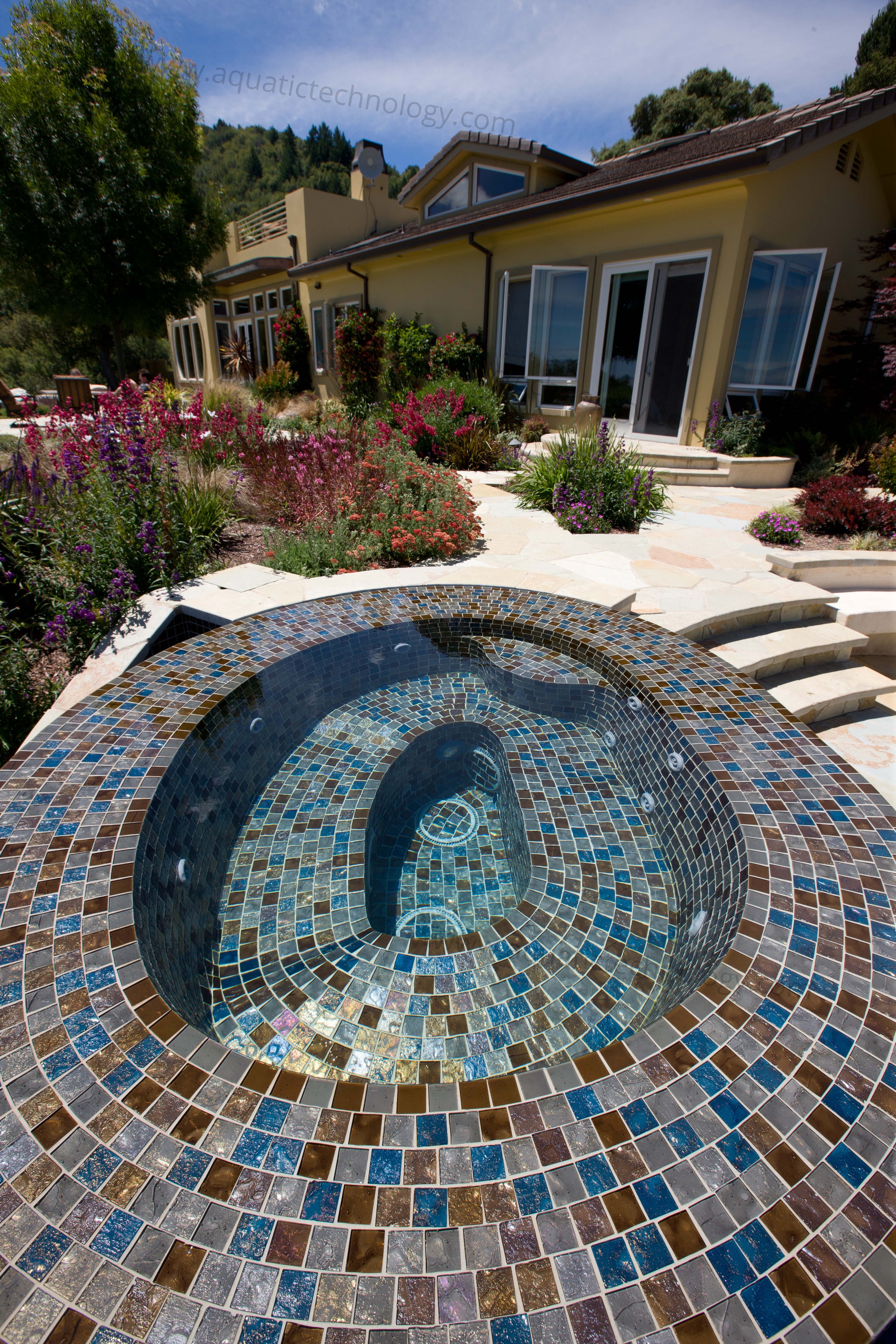 Flooded edge glass tile spa