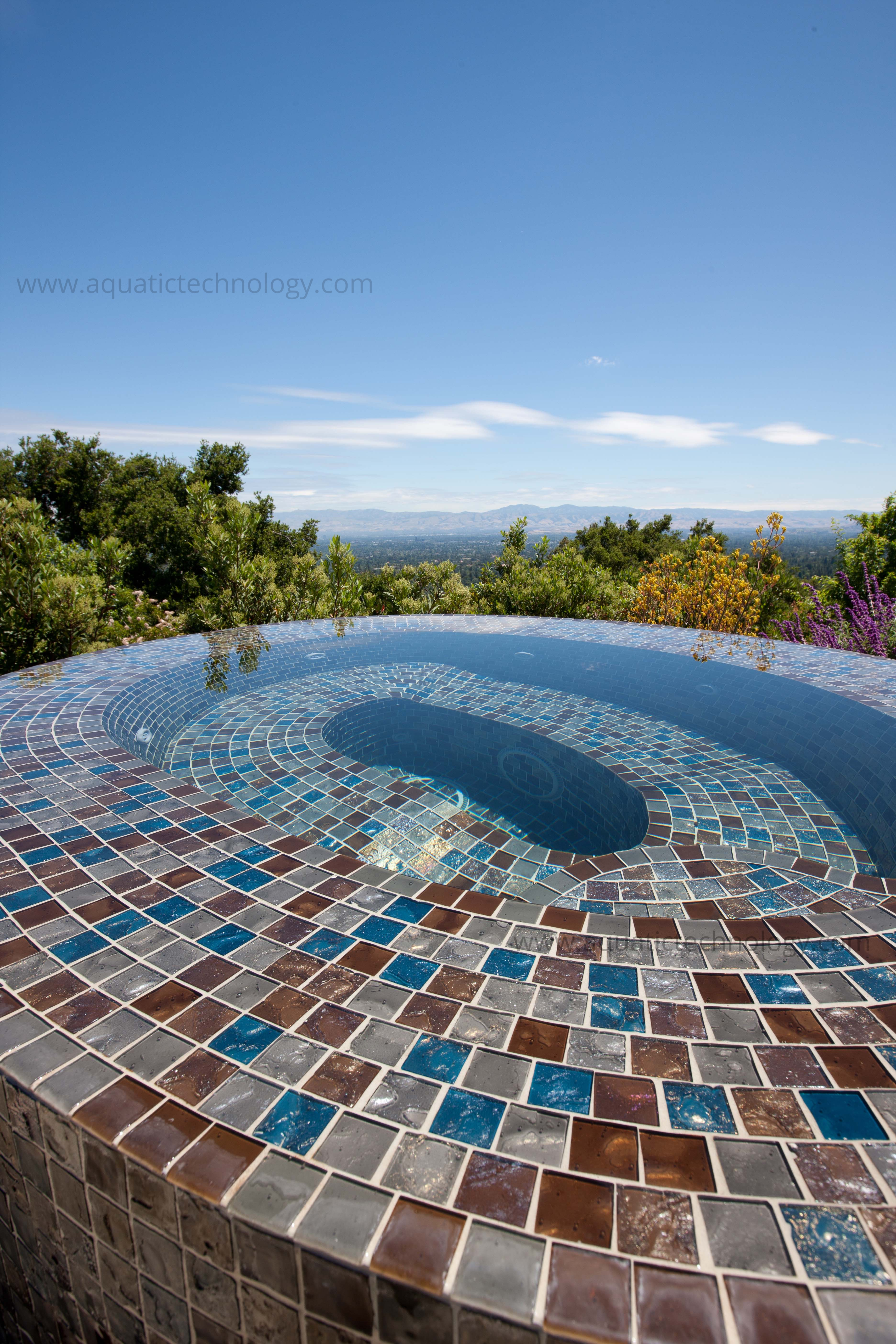 Infinity edge glass tile spa