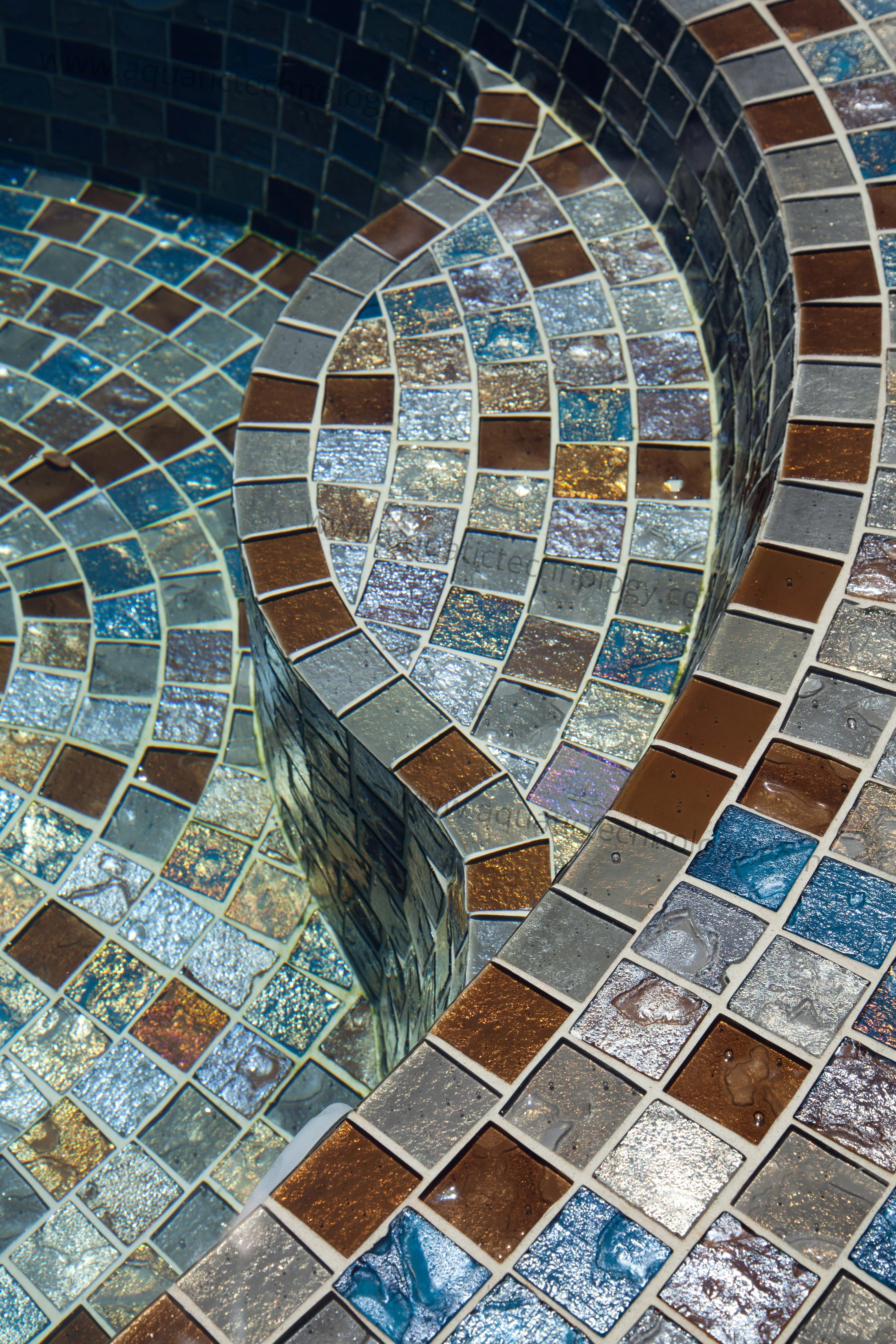 Sloped spa bench glass tile