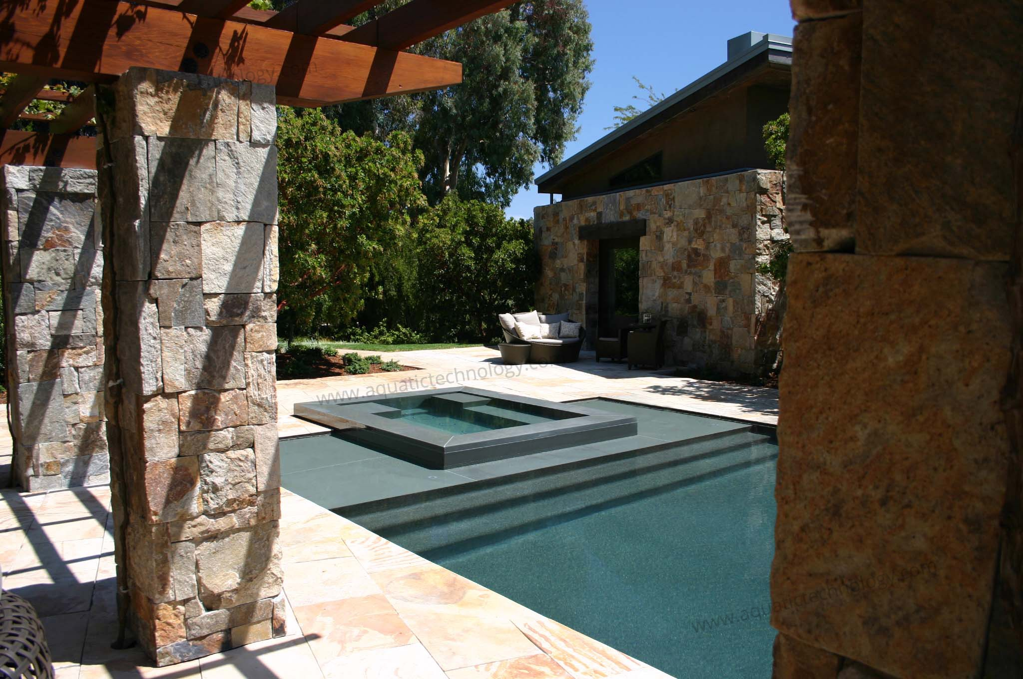 Mosaic glass tile spa vanishing edge pool