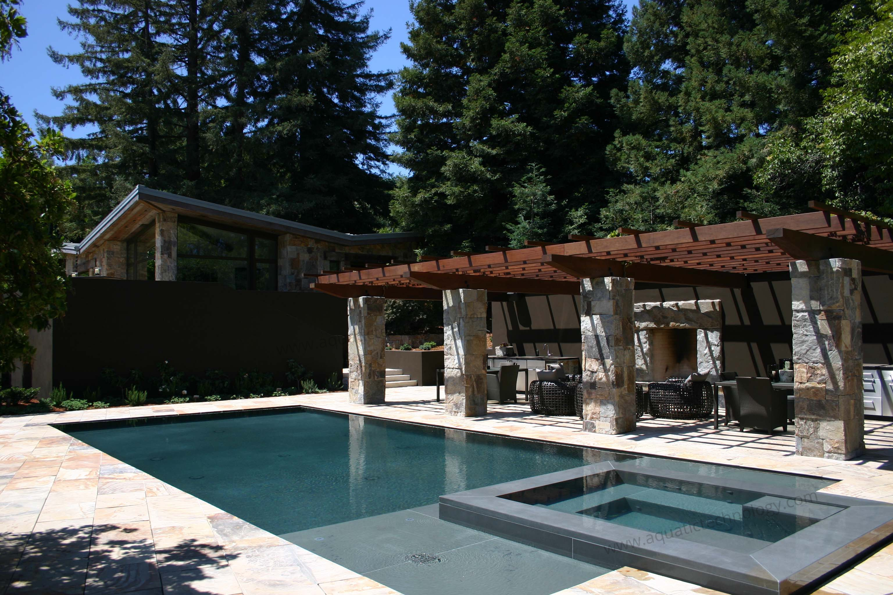 Perimeter overflow spa slot edge pool