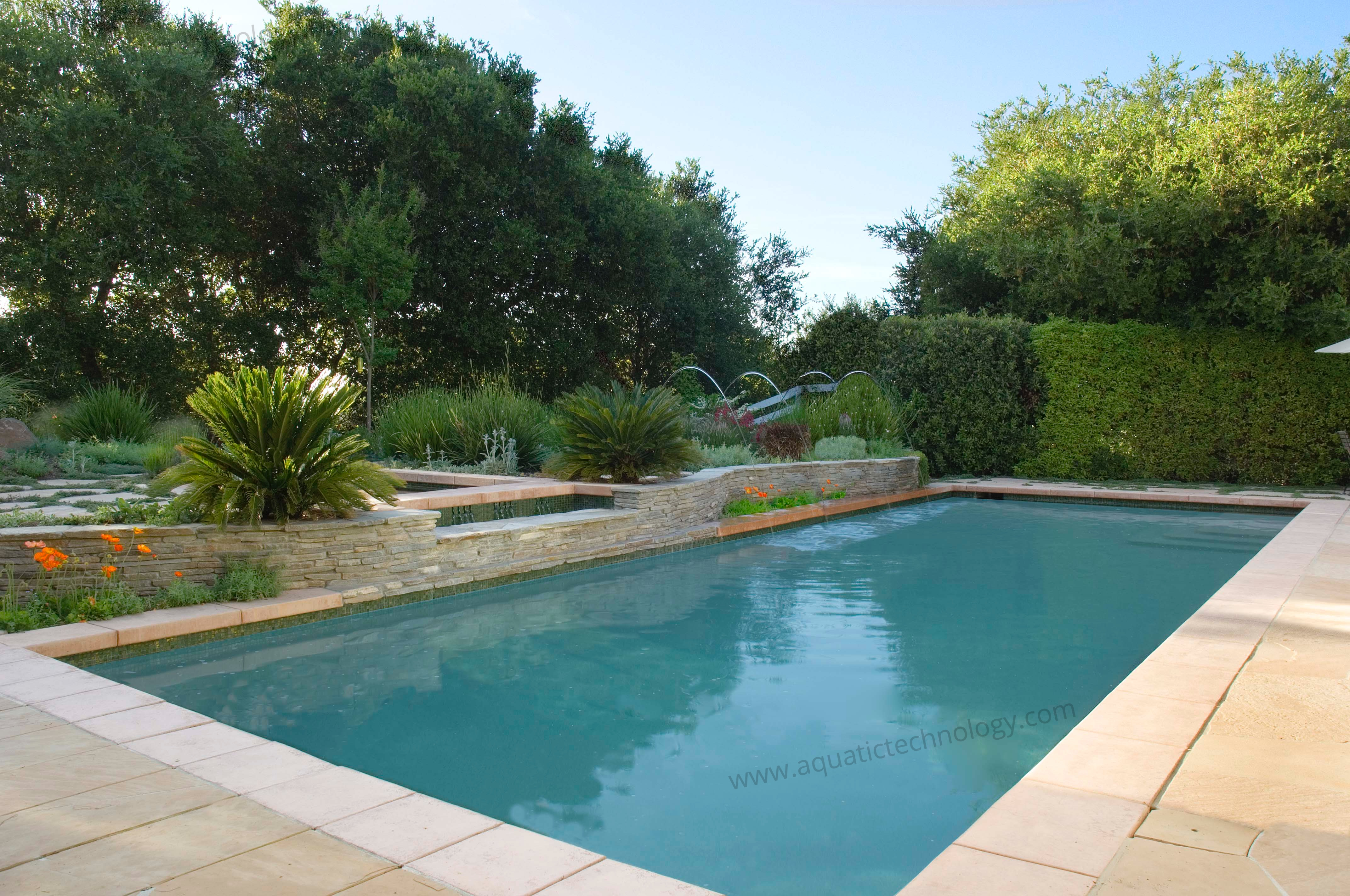 Serpentine ledger stone walls glass tile pool flagstone patio